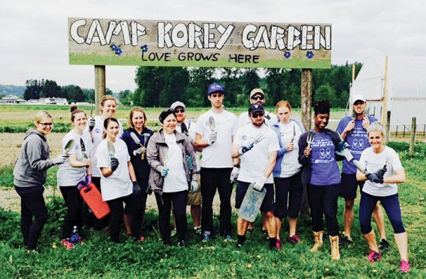 A 14-person team from Brooks after planting four acres of organic gardens for campers at Camp Korey in Carnation, WA.