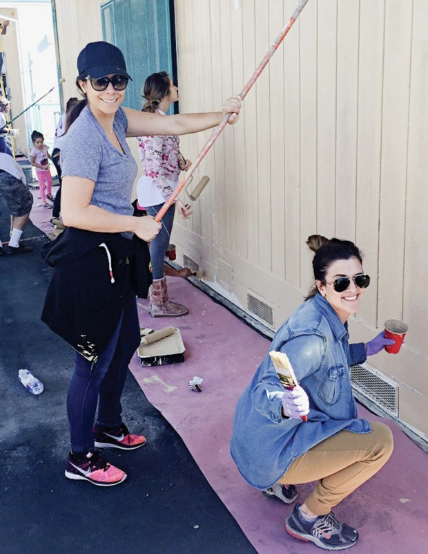 Workers from seven shoe companies come together to give a Southern California school a fresh coat of paint for the Compton Initiative.