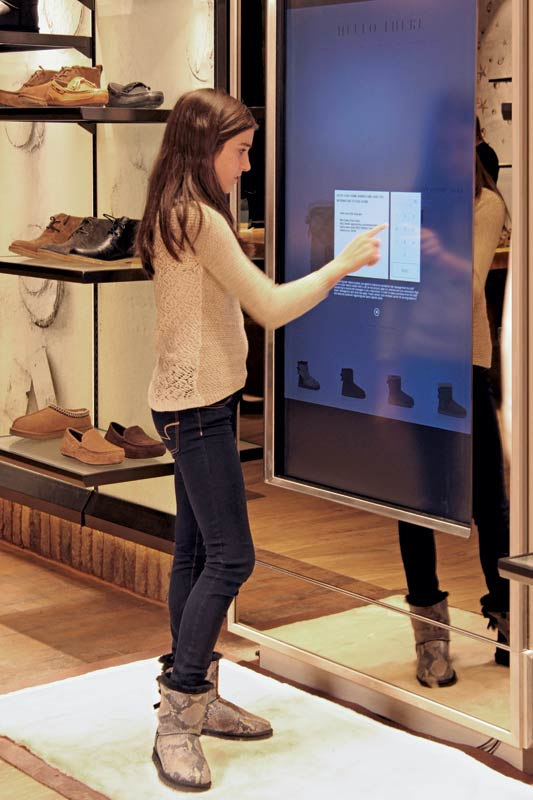 Touchscreen shopping in an Ugg flagship.