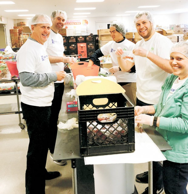 Wolverine Worldwide employees prep after-school meals at Kids' Food Basket in Grand Rapids, MI.